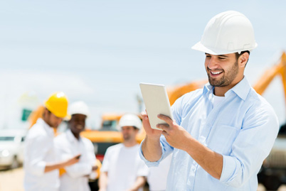 male-engineer-at-a-construction-site-with-a-tablet-computer